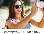 young pretty woman making... | Shutterstock . vector #1043541832