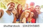 happy friends taking selfie at... | Shutterstock . vector #1043545885