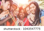 group of happy friends enjoying ... | Shutterstock . vector #1043547775