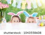 family easter morning. children ... | Shutterstock . vector #1043558608