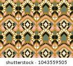 ikat geometric folklore... | Shutterstock .eps vector #1043559505