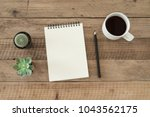 blank notepad with a cup of... | Shutterstock . vector #1043562175