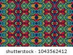 ikat geometric folklore... | Shutterstock .eps vector #1043562412