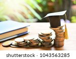 hat graduation model on coins... | Shutterstock . vector #1043563285