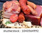 delicious smoked sausages on a... | Shutterstock . vector #1043564992