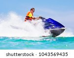 Teenager On Jet Ski. Teen Age...