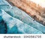 aerial view of waves  rocks and ... | Shutterstock . vector #1043581735