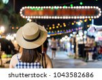 young asian tourist looking ... | Shutterstock . vector #1043582686