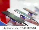 new black mobile smartphones...   Shutterstock . vector #1043585518