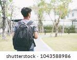 young wanderlust traveler... | Shutterstock . vector #1043588986