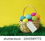colorful easter eggs basket on... | Shutterstock . vector #1043589772