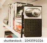 retro handheld transistor radio ...   Shutterstock . vector #1043591026