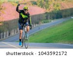 asian man ride a bicycle on the ... | Shutterstock . vector #1043592172