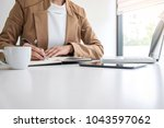 young entrepreneur woman... | Shutterstock . vector #1043597062
