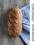delicious loaf of artisan... | Shutterstock . vector #1043613412