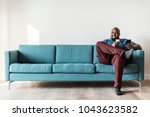 black man using mobile phone | Shutterstock . vector #1043623582