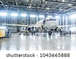 passenger airplane on... | Shutterstock . vector #1043665888