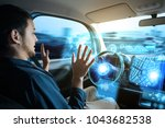 young man riding autonomous car. | Shutterstock . vector #1043682538