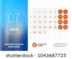 july 2019. desk calendar for... | Shutterstock .eps vector #1043687725