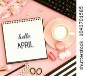 hello april text on notebook.... | Shutterstock . vector #1043701585