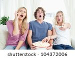three friends enjoying popcorn... | Shutterstock . vector #104372006