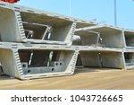 Small photo of stock box girder, box girder, Bridge construction, segmental bridge box girders ready for construction, segments of long span bridge box girder , Thailand, Province Patumthani, Bangkok,construction