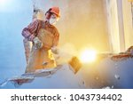 Worker With Sledgehammer At...