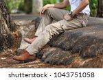 man wearing brown cargo pants... | Shutterstock . vector #1043751058