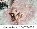 beautiful blond woman lies on a ... | Shutterstock . vector #1043776258