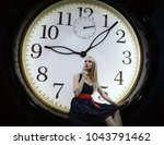 young woman dressed in a dress... | Shutterstock . vector #1043791462