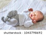 adorable newborn baby girl... | Shutterstock . vector #1043798692