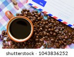 black coffee in cup and coffee... | Shutterstock . vector #1043836252