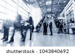 blurred business people in a... | Shutterstock . vector #1043840692