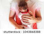 handsome father holding his... | Shutterstock . vector #1043868388