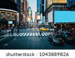 Small photo of Famous Times Square landmark in New York downtown with mock up billboards for advertising and commercial information content. Big metropolis urban scene with development infrastructure with Lighboxes