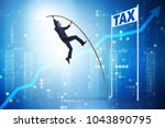 businessman jumping over tax in ... | Shutterstock . vector #1043890795
