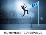businessman jumping over tax in ... | Shutterstock . vector #1043890828