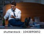 stressed businessman working... | Shutterstock . vector #1043890852