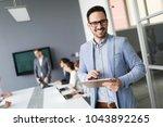 portrait of handsome successful ... | Shutterstock . vector #1043892265