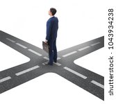 young businessman at crossroads ... | Shutterstock . vector #1043934238