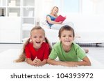 Happy healthy kids at home laughing for the camera - stock photo