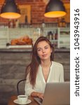beautiful girl with a laptop in ... | Shutterstock . vector #1043943916