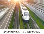 high speed passenger train... | Shutterstock . vector #1043950432