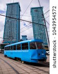 blue tramway on the street in... | Shutterstock . vector #1043954572