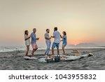 group of men and women having... | Shutterstock . vector #1043955832