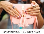 close up of unrecognizable... | Shutterstock . vector #1043957125