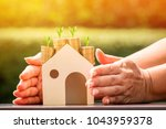 investor hand embracing a stack ...   Shutterstock . vector #1043959378