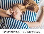 beautiful young woman lying... | Shutterstock . vector #1043969122