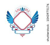 graphic winged emblem composed... | Shutterstock .eps vector #1043975176