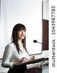 pretty  young business woman... | Shutterstock . vector #1043987785